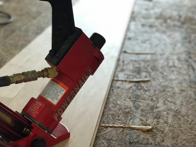 installing hardwood flooring glue assisted with cleat fasteners