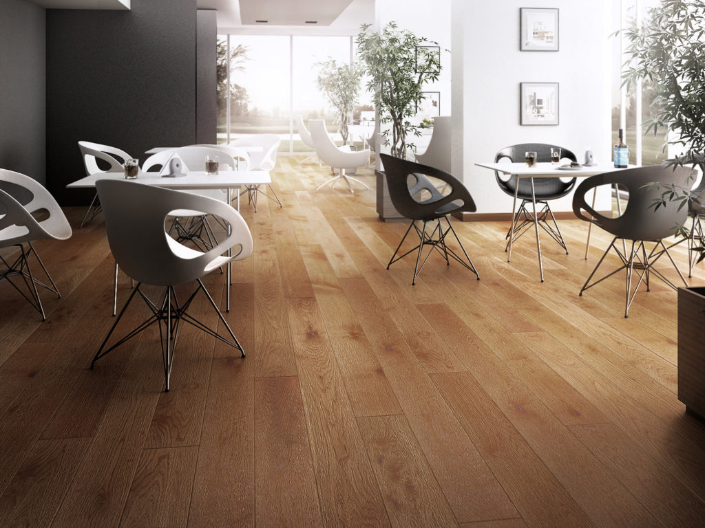 honey wood floor with modern white chairs