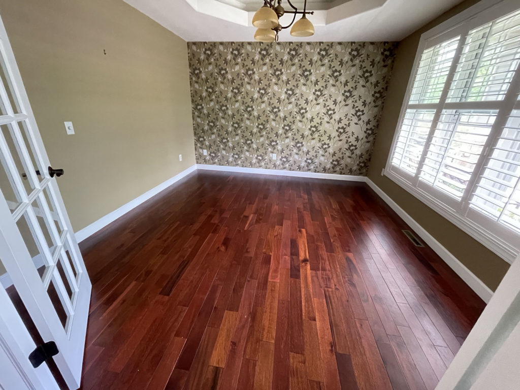 red toned wood floor before